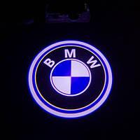 Лазерный логотип в двери BMW