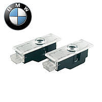 Лазерный логотип на двери авто BMW