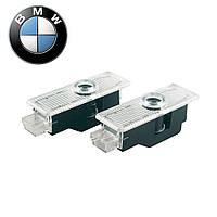 Лазерный логотип в двери автомобиля BMW