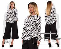 Расклешенная блузка в горошек