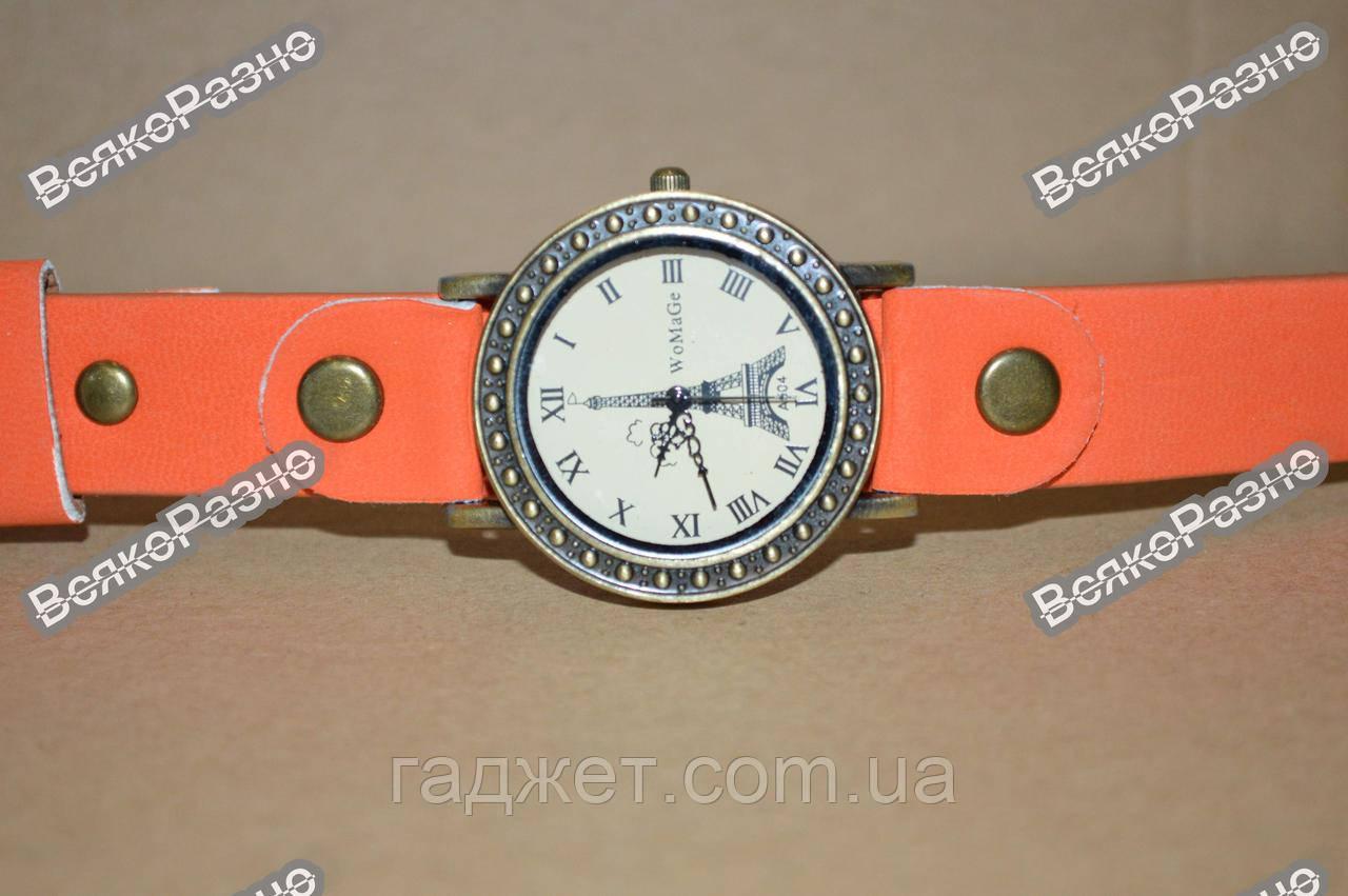 Женские часы с изображением Эйфелевой башни с оранжевым ремешком.