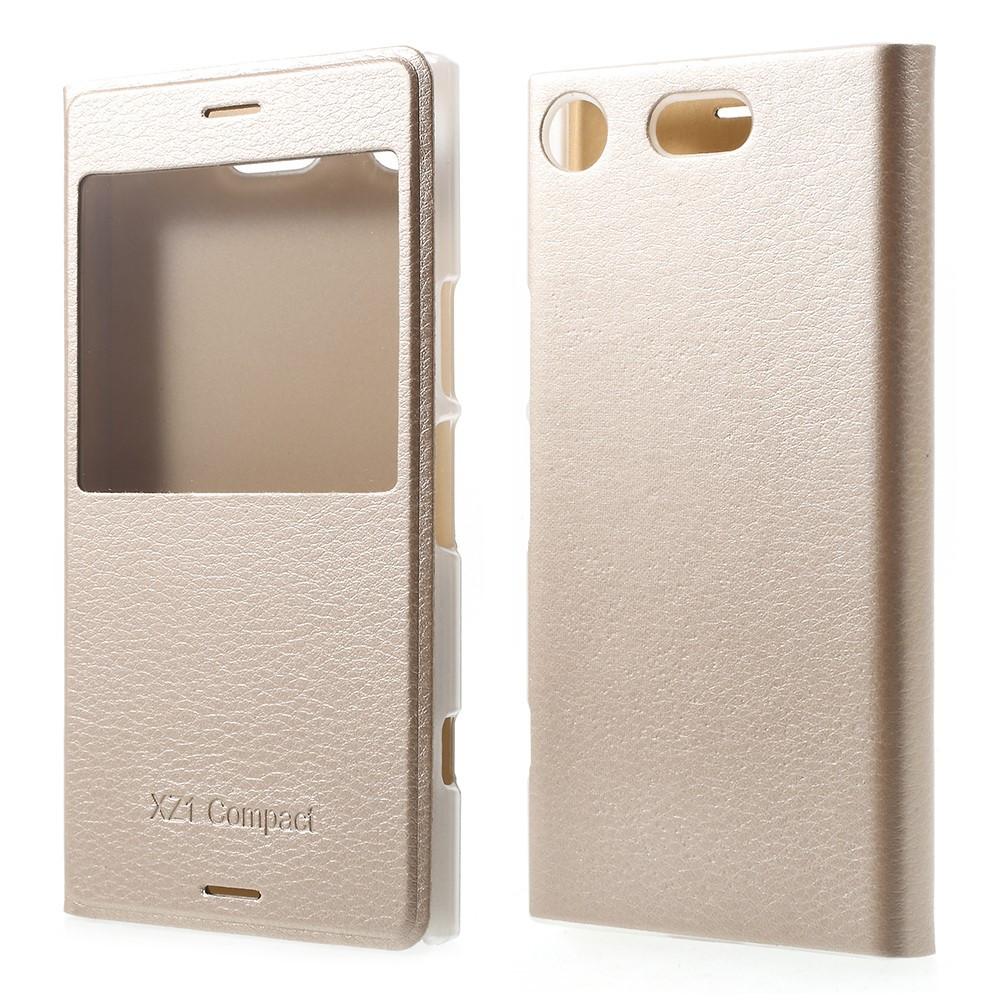 Чехол книжка для Sony Xperia XZ1 Compact боковой с окошком, золотистый