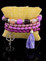 Женский браслет из бусин фиолетовый