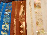 Подарочный набор из трех махровых полотенец. Цвета разные.