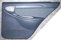 Обивка задней двери Ланос Т 150