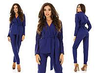 Стильный женский костюм: пиджак на запах с поясом и брюки