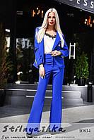 Стильный костюм пиджак с расклешенными брюками синий