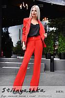 Стильный костюм пиджак с расклешенными брюками красный
