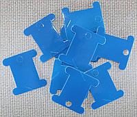 Шпуля картонная.Цвет - тёмно-голубой