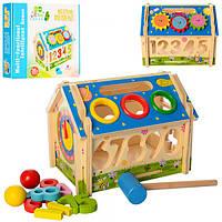 Деревянная игрушка Игра M01454  домик, сортер (цифры), стучалка, часы, в кор-ке, 27-24-5см