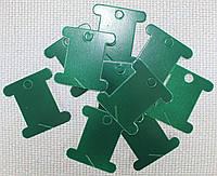 Шпуля картонная.Цвет - тёмно-зелёный
