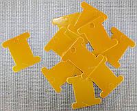 Шпуля картонная.Цвет - жёлтой дыни