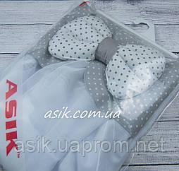 Балдахин в кроватку с тканевой оборкой с белым горошком на сером фоне