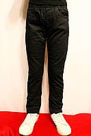 Зимові дитячі штани чорного кольору на флісі на резинці хлопчикам віком 4-12 років. Виробник Польша.