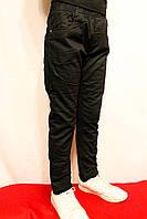 Зимові дитячі штани чорного кольору на флісі на резинці хлопчикам 146-152см. Виробник Польша.