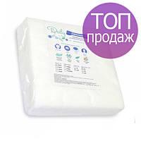 Безворсовые салфетки Doily 20х20см 40г/м2, гладкие/сетка, 100 шт в пластах