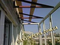 Остекление балконов с крышей по Киеву и Киевской области