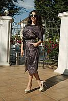 Красивое женское платье с поясом прорехой на переди