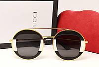 Женские солнцезащитные очки Gucci GG0105 (цвет черно белый)