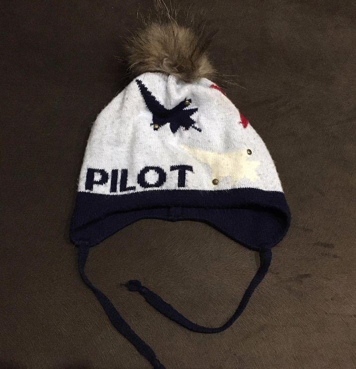 Детская зимняя шапка с меховым натуральным бубоном б/у
