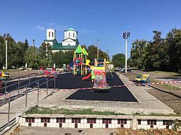 Устройство бесшовного покрытия для детской площадки 15