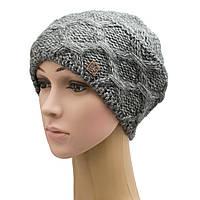 Зимняя вязанная женская крупной вязки шапка меланжированной нитки