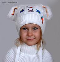 Белая детская зимняя шапка с двумя ушками и красивой вышивкой