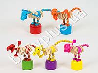 Деревянная игрушка Дергунчик Динозавр, микс цветов, в кульке E12576
