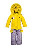 Детский зимний комбинезон для девочки желтого цвета