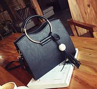Каркасная женская сумка с круглыми ручками