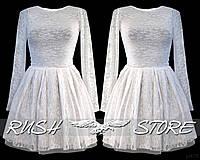 Расклешенное платье из гипюра