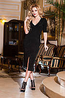Женское платье облегающего кроя с карманами