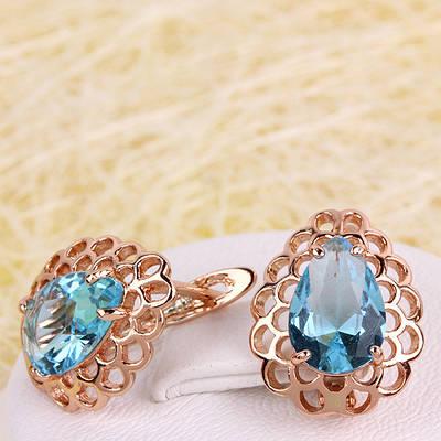 008-4278 - Ажурные серьги с голубыми фианитами розовая позолота