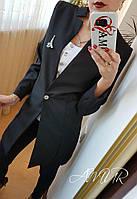 Женский удлиненный пиджак с выпрямленным воротником