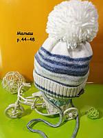 Детская зимняя шапочка на завязках на флисе