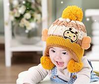 Шапочка детская зимняя вязанная с помпоном