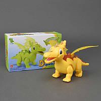 Динозавр 1014 А (36/2) звук - рычит, свет, ходит, проектор,  2 вида, на батарейке, в коробке