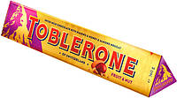 Молочный  шоколад Toblerone  c изюмом, нугой из меда и миндаля , 100 гр