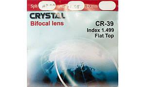 Полимерная бифокальная линза Crystal с сегментом (правый, левый). Индекс 1,499.