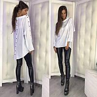Белая женская рубашка свободного кроя
