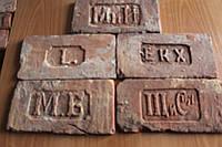 Плитка из старинного кирпича с клеймом