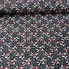 Ткань с ажурной веточкой и красным цветочком на графитовом фоне, ширина 145 см