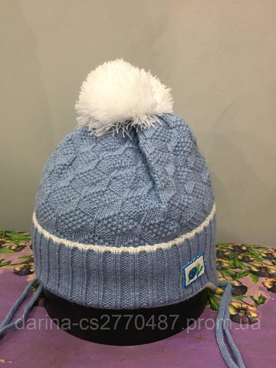 Теплая шапка на завязках для мальчика