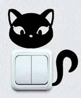Виниловая интерьерная наклейка - Кошка на розетку 1 (от 5х7 см)