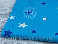 Лоскут ткани №934а с звёздами разной величины синего и белого цвета на тёмно-бирюзовом фоне