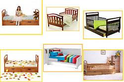 Дитячі дерев'яні односпальні ліжка.