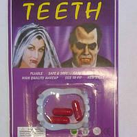 """Зубы с капсулами""""крови"""" , зубы вампира."""