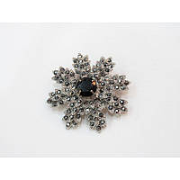 Брошка серебряный цветочек с черными камушками