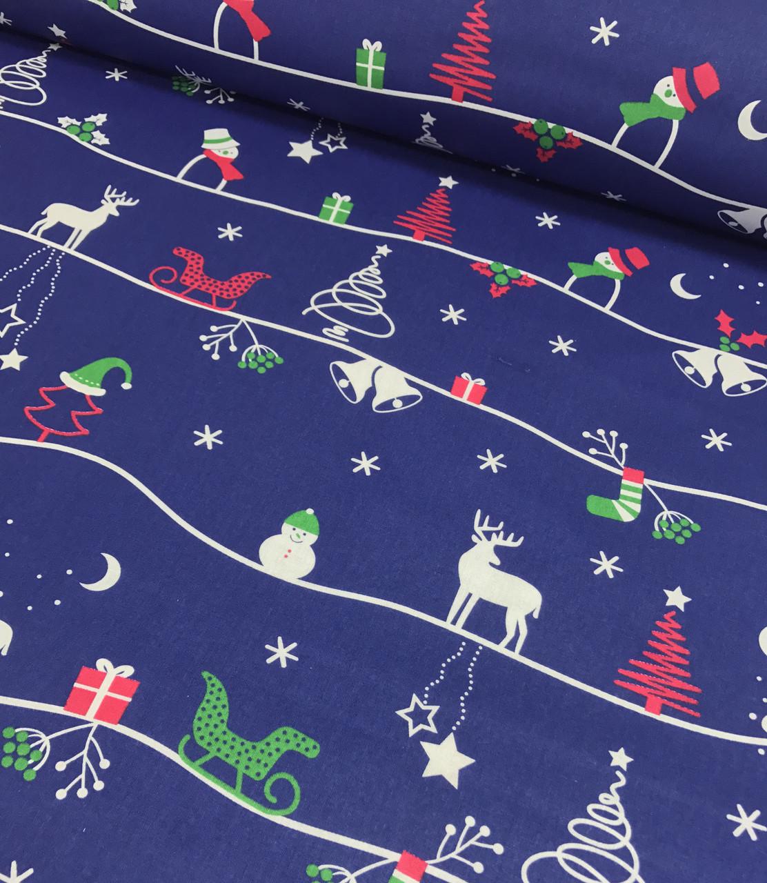 Новогодняя ткань польская олени, снеговики, елочки на синем №340
