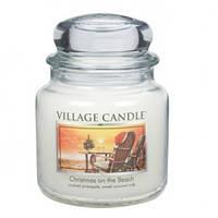 """Ароматическая свеча в стекле Village Candle """"Рождество на пляже"""". 455 гр/ 105 часов"""